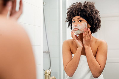 Seven Things Dermatologists Always Do to Their Faces